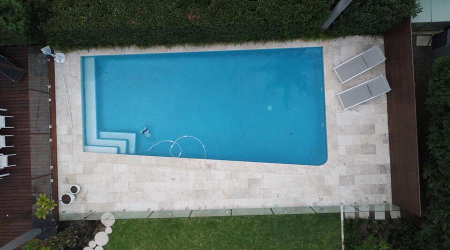 classic travertine pool aeral shot
