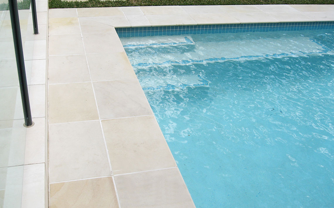 pool surrounds sandstone